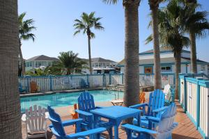 Close to shopping and restaurants and within 2 blocks of the sandy white beach is the Surfside RV & Resort. Relax in luxury with full hook-up sites with concrete pads and cable TV available. Commercial Laundromat, full size bath house, wide concrete streets, fish cleaning station and the Trolley stops in front of the campground.